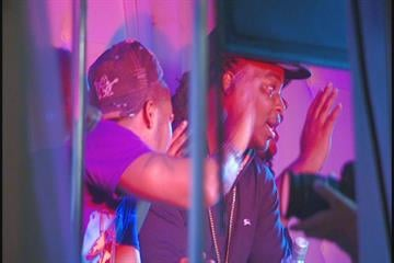 Rappers Chingy (L) and Huey (R) wave for the camera during Huey's music video shoot on July 7. By KMOV Web Producer