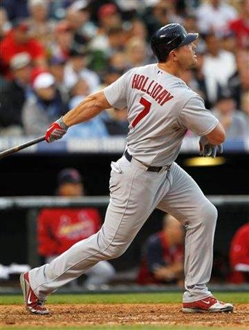 St. Louis Cardinals' Matt Holliday watches his solo home run against the Colorado Rockies in the fifth inning of a baseball game in Denver on Wednesday, July 7, 2010. (AP Photo/David Zalubowski) By David Zalubowski