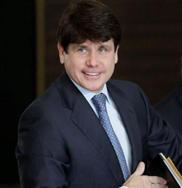 Former Illinois Gov. Rod Blagojevich smiles as he arrives at the federal building in Chicago, Wednesday, July 7, 2010,  for his corruption trial. (AP Photo/M. Spencer Green) By M. Spencer Green