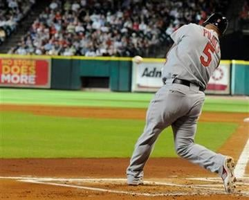 St. Louis Cardinals' Albert Pujols connects for an RBI double in the first inning of a baseball game against the Houston Astros Friday, July 9, 2010 in Houston. (AP Photo/Pat Sullivan) By Pat Sullivan