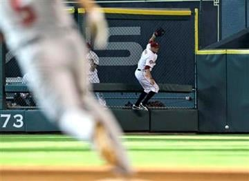 Houston Astros right fielder Hunter Pence, right, tries to catch a triple hit by St. Louis Cardinals' Albert Pujols, left, during the fourth inning of a baseball game Saturday, July 10, 2010 in Houston. (AP Photo/David J. Phillip) By David J. Phillip