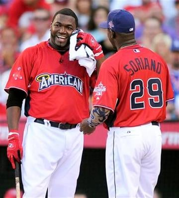 Boston Red Sox's David Ortiz, left, gets a towel from Tampa Bay Rays' Rafael Soriano during a break in baseball's All-Star home run derby Monday, July 12, 2010, in Anaheim, Calif. (AP Photo/Mark J. Terrill) By Mark J. Terrill