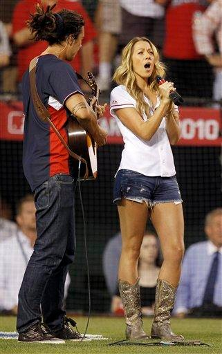 "Colbie Caillat sings ""God Bless America"" during the seventh-inning stretch of the All-Star baseball game Tuesday, July 13, 2010, in Anaheim, Calif. (AP Photo/Chris Carlson) By Chris Carlson"