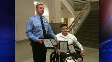 "Officer Joseph Haman (r) receives the ""Officer of the Year"" award from the St. Louis Police Department"