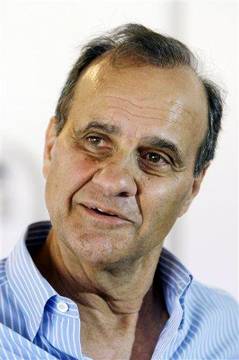 Former New York Yankees manager and current Los Angeles Dodgers manager Joe Torre talks about his former boss and mentor, George Steinbrenner, at a Dodger Stadium news conference Tuesday, July 13, 2010, in Los Angeles. (AP Photo/Reed Saxon) By Reed Saxon
