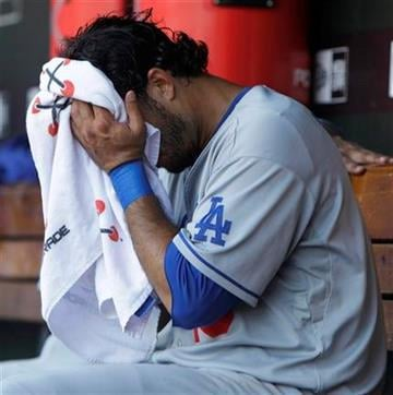 Los Angeles Dodgers' Andre Ethier sits in the dugout after losing 5-4 to the St. Louis Cardinals in baseball game Sunday, July 18, 2010, in St. Louis.  (AP Photo/Jeff Roberson) By Jeff Roberson