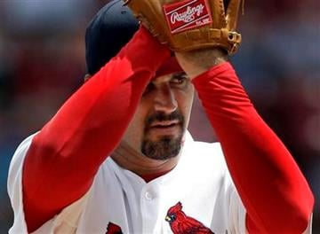 St. Louis Cardinals starting pitcher Jeff Suppan winds up during the first inning of a baseball game against the Los Angeles Dodgers on Sunday, July 18, 2010, in St. Louis. (AP Photo/Jeff Roberson) By Jeff Roberson
