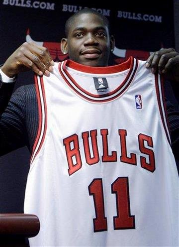 The Chicago Bulls' new guard, Ronnie Brewer, holds up his jersey during a news conference Monday, July 19, 2010, in Chicago. Brewer joins former Utah Jazz teammates Carlos Boozer and Kyle Korver in Chicago. (AP Photo/Kiichiro Sato) By Kiichiro Sato