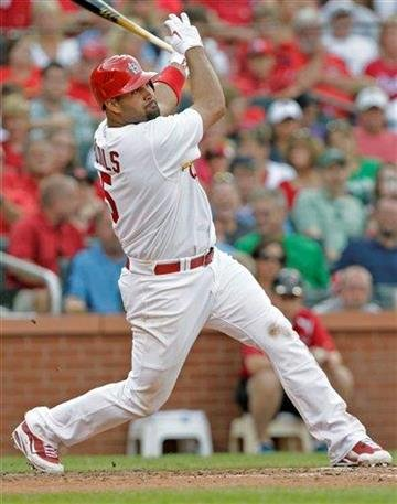 St. Louis Cardinals first baseman Albert Pujols (5) connects for a double in the third inning of a baseball game against the Philadelphia Phillies, Monday, July 19, 2010 in St. Louis.(AP Photo/Tom Gannam) By Tom Gannam