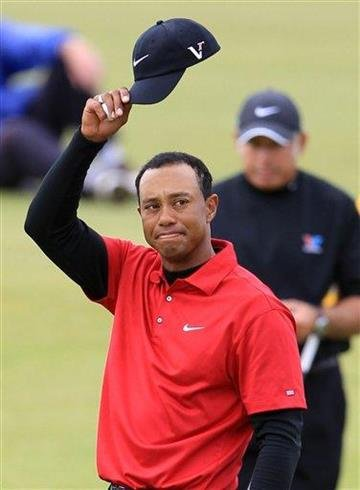 Tiger Woods of the United States waves to the crowd on the 18th green after completing his final round of the British Open Golf Championship on the Old Course at St. Andrews, Scotland, Sunday, July 18, 2010. (AP Photo/Tim Hales) By Tim Hales