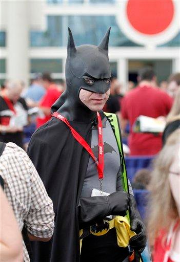 Garth Bauman dressed as Batman waits in line to get into the preview night at Comic-Con International Wednesday, July 21, 2010 in San Diego.  (AP Photo/Denis Poroy) By Denis Poroy