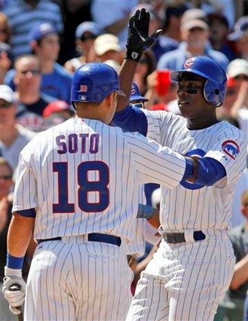 Chicago Cubs' Alfonso Soriano, right, celebrates with Geovany Soto after hitting a two-run home run against the St. Louis Cardinals during the fifth inning of a baseball game Friday, July 23, 2010, in Chicago.(AP Photo/Nam Y. Huh) By Nam Y. Huh