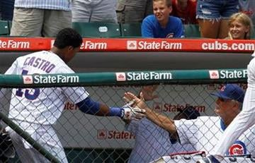 Chicago Cubs' Starlin Castro, left, celebrates with manager Lou Piniella after hitting a two-run home run against the St. Louis Cardinals during the third inning of a baseball game Saturday, July 24, 2010, in Chicago.(AP Photo/Nam Y. Huh) By Nam Y. Huh
