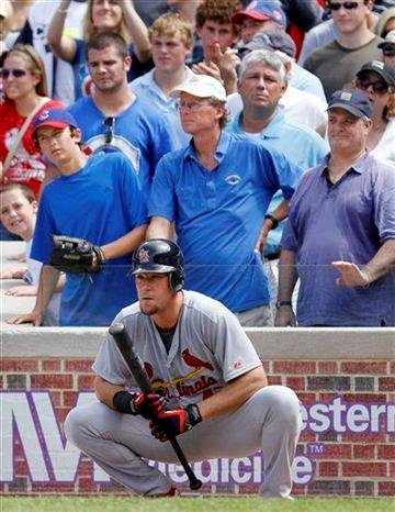 St. Louis Cardinals' Ryan Ludwick watches teammate Matt Holliday play against the Chicago Cubs during the ninth inning of a baseball game Saturday, July 24, 2010, in Chicago. The Cubs won 6-5.(AP Photo/Nam Y. Huh) By Nam Y. Huh