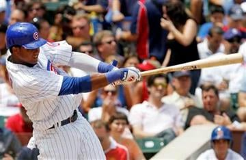 Chicago Cubs' Starlin Castro hits a two-run home run against the St. Louis Cardinals during the third inning of a baseball game, Saturday, July 24, 2010, in Chicago.(AP Photo/Nam Y. Huh) By Nam Y. Huh