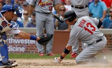 St. Louis Cardinals' Brendan Ryan, right, scores on Tyler Greene's two-run single as Chicago Cubs catcher Geovany Soto applies a late tag during the second inning of a baseball game Saturday, July 24, 2010, in Chicago.(AP Photo/Nam Y. Huh) By Nam Y. Huh