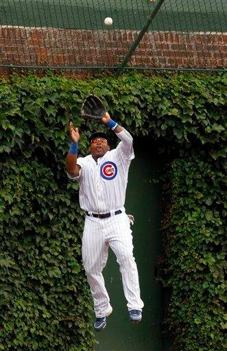 Chicago Cubs center fielder Marlon Byrd makes a leaping catch on a fly ball hit by St. Louis Cardinals' Yadier Molina during the second inning of a baseball game, Saturday, July 24, 2010, in Chicago.(AP Photo/Nam Y. Huh) By Nam Y. Huh