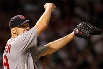 St. Louis Cardinals starter Chris Carpenter wipes his face after hitting a single by Chicago Cubs' Alfonso Soriano during the sixth inning of a baseball game Sunday, July 25, 2010, in Chicago.(AP Photo/Nam Y. Huh) By Nam Y. Huh