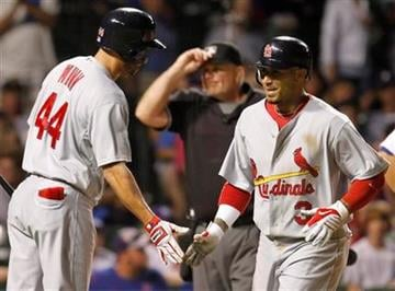 St. Louis Cardinals' Felipe Lopez, right, celebrates with Randy Winn after hitting a solo home run against the Chicago Cubs during the 11th inning of a baseball game Sunday, July 25, 2010, in Chicago. (AP Photo/Nam Y. Huh) By Nam Y. Huh