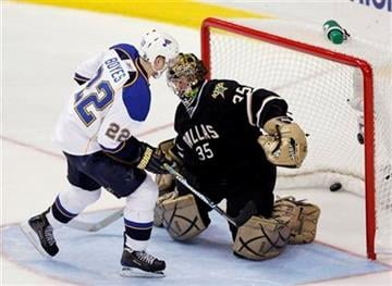 St. Louis Blues right wing Brad Boyes (22) scores in the shootout against Dallas Stars goalie Marty Turco (35) in an NHL hockey game, Wednesday, Nov. 25, 2009, in Dallas. The Blues won 4-3. (AP Photo/Brandon Wade) By Brandon Wade