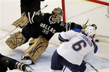 St. Louis Blues defenseman Erik Johnson (6) scores on Dallas Stars goalie Marty Turco during the first period of an NHL hockey game, Wednesday, Nov. 25, 2009, in Dallas. (AP Photo/Brandon Wade) By Brandon Wade