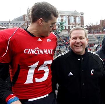 Cincinnati head coach Brian Kelly, right, walks with quarterback Tony Pike, left, after Cincinnati beat Illinois 49-36 in an NCAA college football game, Friday, Nov. 27, 2009 in Cincinnati.  (AP Photo/David Kohl) By David Kohl