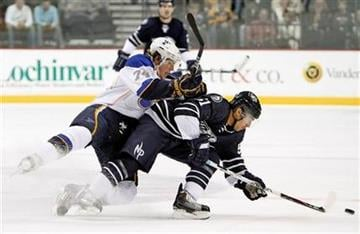 Nashville Predators defenseman Francis Bouillon (51) beats St. Louis Blues center T. J. Oshie (74) to the puck in the first period of an NHL hockey game on Friday, Nov. 27, 2009, in Nashville, Tenn. (AP Photo/Mark Humphrey) By Mark Humphrey