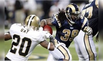 St. Louis Rams running back Steven Jackson (39), right, runs for yardage past New Orleans Saints cornerback Randall Gay, left, during the second quarter of an NFL football game Sunday, Nov. 15, 2009, in St. Louis. (AP Photo/Tom Gannam) By Tom Gannam