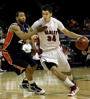 Bradley's Milos Knezevic, right, drives around Illinois' Dominique Keller during an NCAA college basketball game at the Las Vegas Invitational in Las Vegas on Saturday, Nov. 28, 2009. (AP Photo/Laura Rauch) By Laura Rauch