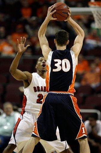 Illinois' Bill Cole (30) is guarded by Bradley's Chris Roberts, left, during an NCAA college basketball game at the Las Vegas Invitational in Las Vegas on Saturday, Nov. 28, 2009. (AP Photo/Laura Rauch) By Laura Rauch