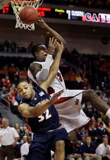 Illinois' Demetri McCamey, bottom, and Bradley's Taylor Brown, top, collide during an NCAA college basketball game at the Las Vegas Invitational in Las Vegas on Saturday, Nov. 28, 2009. (AP Photo/Laura Rauch) By Laura Rauch