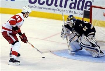 Detroit Red Wings' Todd Bertuzzi (44) sets up to score the game-winning goal against St. Louis Blues goalie Chris Mason (50) in a shootout during an NHL hockey game Saturday, Nov. 28, 2009, in St. Louis. (AP Photo/Bill Boyce) By Bill Boyce