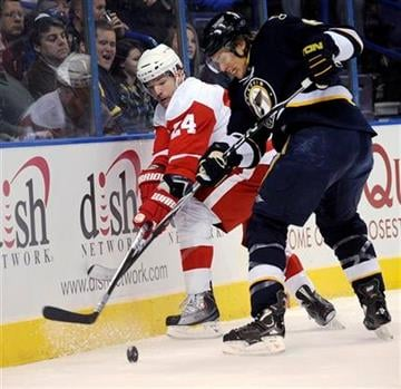 St. Louis Blues' Erik Johnson, right, and Detroit Red Wings' Brad May (24) fight for a loose puck in the first period of an NHL hockey game Saturday, Nov. 28,  2009, in St. Louis. (AP Photo/Bill Boyce) By Bill Boyce