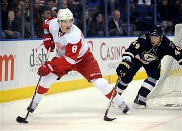 Detroit Red Wings' Justin Abdelkader (8) looks to pass as St. Louis Blues' Darryl Sydor (44) defends in the first period of an NHL hockey game Saturday, Nov. 28, 2009, in St. Louis. (AP Photo/Bill Boyce) By Bill Boyce