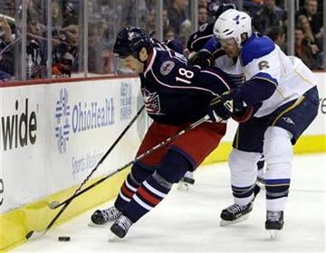 Columbus Blue Jackets' R.J. Umberger, left, and St. Louis Blues' Erik Johnson fight for a loose puck during the second period of an NHL hockey game Monday, Nov. 30, 2009, in Columbus, Ohio. (AP Photo/Jay LaPrete) By Jay LaPrete