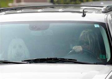 Elin Nordegren, wife of golfer Tiger Woods, leaves the Isleworth subdivision in Windermere, Fla., on Saturday, Nov. 28, 2009. (AP Photo/Phelan M. Ebenhack) By Phelan M. Ebenhack