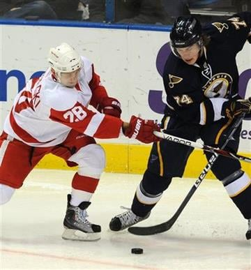 St. Louis Blues' TJ Oshie (74) and Detroit Red Wings' Brian Rafalski (28) battle for the puck in the second period of an NHL  hockey game Saturday, Nov. 28,  2009, in St. Louis. (AP Photo/Bill Boyce) By Bill Boyce