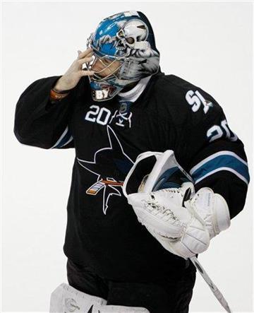 San Jose Sharks goalie Evgeni Nabokov (20) wipes his eye after the San Jose Sharks lost to the St. Louis Blues 3-2 in overtime in an NHL hockey game in San Jose, Calif., Thursday, Dec. 3, 2009. (AP Photo/Paul Sakuma) By Paul Sakuma