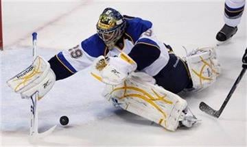 St. Louis Blues goalie Ty Conklin (29) dives on a puck in the first period of an NHL hockey game against the San Jose Sharks in San Jose, Calif., Thursday, Dec. 3, 2009. (AP Photo/Paul Sakuma) By Paul Sakuma
