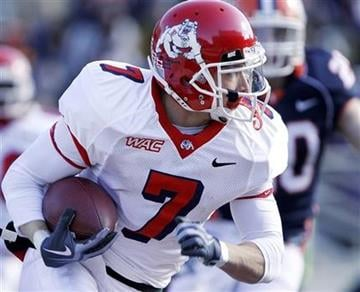 Fresno State's Devon Wylie (7) looks for running room against Illinois during the first half of an NCAA college football game in Champaign, Ill., Saturday, Dec 5, 2009. (AP Photo/Seth Perlman) By Seth Perlman
