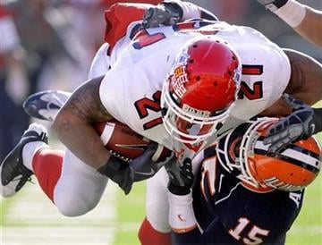 Fresno State's Ryan Mathews (21) goes over Illinois' Chris Duvalt (15) during the second half of an NCAA college football game in Champaign, Ill., Saturday, Dec 5, 2009. Fresno State won 53-52. (AP Photo/Seth Perlman) By Seth Perlman