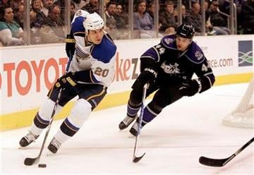 St. Louis Blues center Alexander Steen (20) moves the puck defended by Los Angeles Kings defenseman Davis Drewiske (44) in the first period of an NHL hockey game in Los Angeles on Saturday, Dec. 5, 2009.  (AP Photo/Jason Redmond) By Jason Redmond