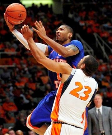 Boise State forward Daequon Montreal (2) puts up a shot past Illinois forward Dominique Keller (23) during the second half of an NCAA college basketball game on Saturday, Dec. 5, 2009, in Champaign, Ill. (AP Photo/Darrell Hoemann) By Darrell Hoemann