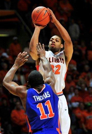 Illinois guard Demetri McCamey (32) puts up a three pointer over Boise State guard Anthony Thomas (11) during the first half of an NCAA college basketball game on Saturday, Dec. 5, 2009, in Champaign, Ill. (AP Photo/Darrell Hoemann) By Darrell Hoemann