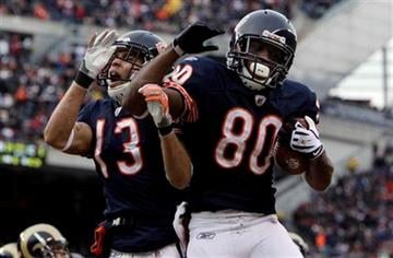 Chicago Bears wide receiver Earl Bennett (80) celebrates his touchdown against the St. Louis Rams with teammate Johnny Knox during the second half of an NFL football game in Chicago, Sunday, Dec. 6, 2009. (AP Photo/M. Spencer Green) By M. Spencer Green