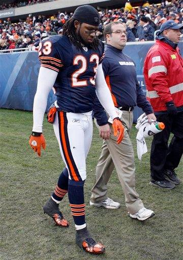 Chicago Bears' Devin Hester (23) leaves the field after an injury during the third quarter of an NFL football game against the St. Louis Rams in Chicago, Sunday, Dec. 6, 2009. (AP Photo/Nam Y. Huh) By Nam Y. Huh