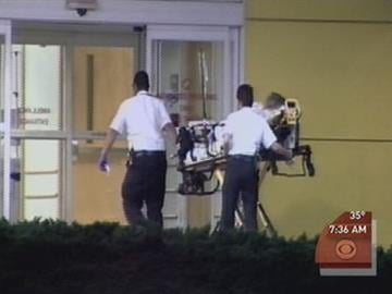 Woman from Tiger Woods' complex taken to the hospital on a stretcher By Afton Spriggs