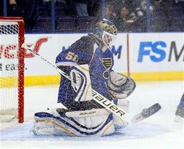 St. Louis Blues goalie Chris Mason makes a save despite being showered with ice in the first period of an NHL hockey game against the Colorado Avalanche, Monday, Dec. 7, 2009 in St. Louis.(AP Photo/Tom Gannam) By Tom Gannam