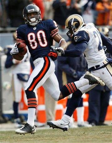 Chicago Bears wide receiver Earl Bennett (80) picks up a few yards against St. Louis Rams safety Oshiomogho Atogwe (21) during the first half of an NFL football game in Chicago, Sunday, Dec. 6, 2009. (AP Photo/Nam Y. Huh) By Nam Y. Huh