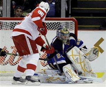 St. Louis Blues goalie Ty Conklin, right, stops a Detroit Red Wings' Tomas Homstrom, of Sweden, shot in the second period of an NHL hockey game in Detroit, Wednesday, Dec. 9, 2009. (AP Photo/Paul Sancya) By Paul Sancya